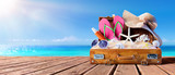 Beach Accessories In Suitcase On Wooden Pier - Travel Concept - 207345574