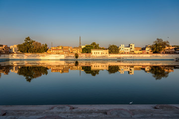Waterfront Reflection of Houses in Bikaner India