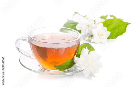 Glass cup of Tea with jasmine flowers and leaves isolated on white background