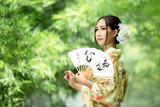 Asian girls wearing traditional Japanese kimono.