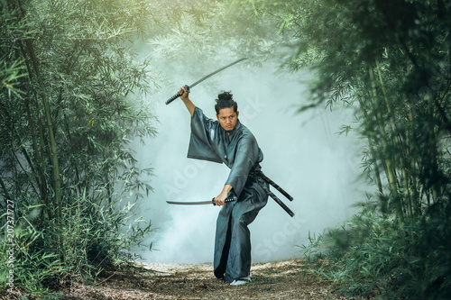 The Japanese samurai are gripping the sword, preparing to fight. © tong2530