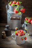 Ripe and sweet wild strawberries in the old metal mug - 207374502