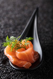 Salted salmon with dill on the background of black sesame. - 207378108
