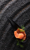 Salted salmon with dill on the background of black sesame. - 207378128