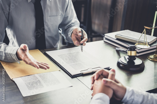 Fototapeta Customer service good cooperation, Consultation between a Businessman and Male lawyer or judge consult having team meeting with client, Law and Legal services concept