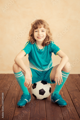 Fotobehang Voetbal Child is pretending to be a soccer player