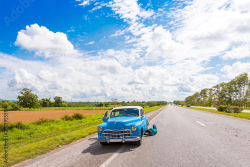 VINALES, CUBA - MAY 13, 2017: American retro car on the road. Copy space for text.