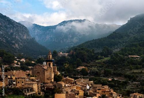 Fotobehang Chocoladebruin Small mediterranean village among mountains in Mallorca, Spain.