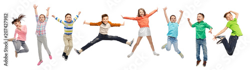Leinwanddruck Bild happiness, childhood, freedom, movement and people concept - happy kids jumping in air over white background