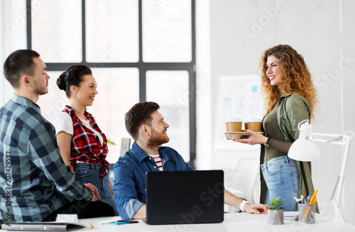 business and people concept - happy creative team with coffee working at office