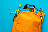 Back to school concept. Backpack with school supplies. Top view. Copy space - 207431735