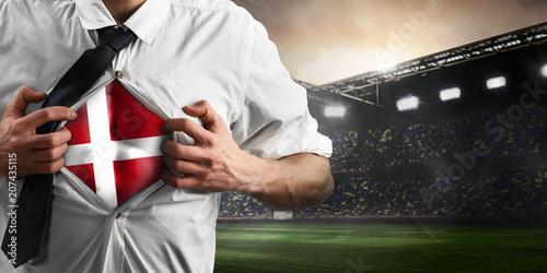 Aluminium Voetbal Denmark soccer or football supporter showing flag under his business shirt on stadium.