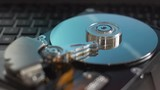 Cinemagraph. Working process of disassembled hard drive. Blue reflections on plates. - 207440743