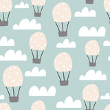 Childish seamless pattern with hot air ballon in the sky. Cute cartoon background. Perfect for fabric, textile, wrapping.Vector Illustration - 207446908