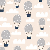 Childish seamless pattern with hot air ballon in the sky. Cute cartoon background. Perfect for fabric, textile, wrapping.Vector Illustration - 207446911