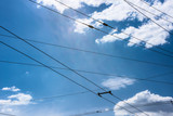 Trolleybus wires and sky with clouds