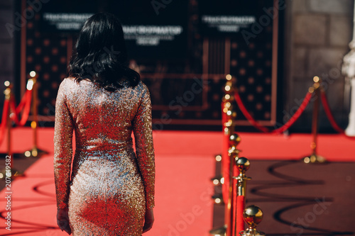 Foto Murales Woman in a luxurious dress on a red carpet