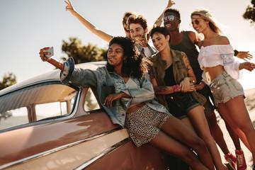 Friends on road trip posing for a selfie