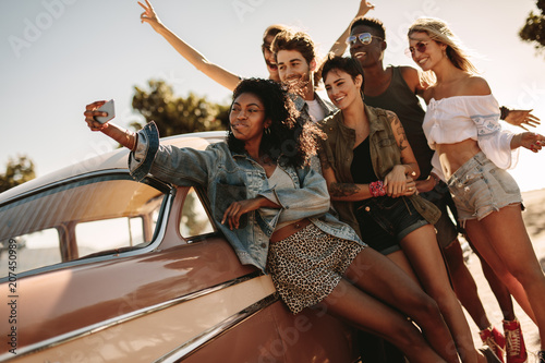 Friends on road trip posing for a selfie