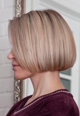 hairstyle a short bean on a blonde girl in a beauty salon Chelyabinsk, russia June 1, 2018