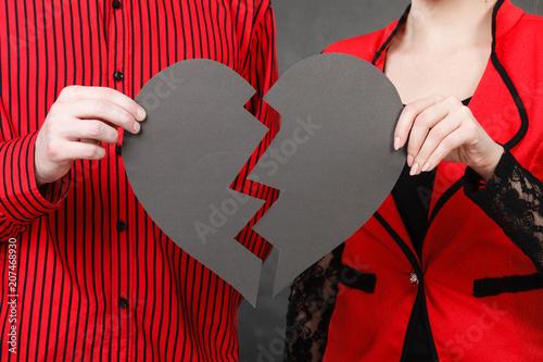 Man and woman holding broken heart