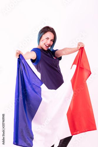 Aluminium Voetbal Portrait d'une jeune supportrice de l'équipe de France de football, le drapeau national dans ses mains