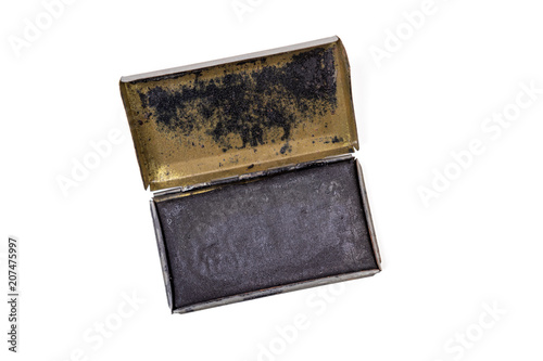 Vintage ink pad in a metal case, likely used in the US Army World War II, isolated on white