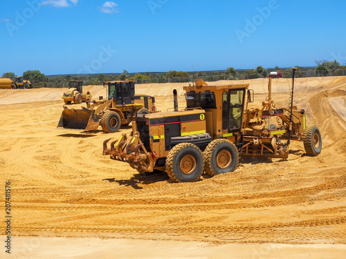 Fotobehang Trekker Heavy machineries working on large construction site