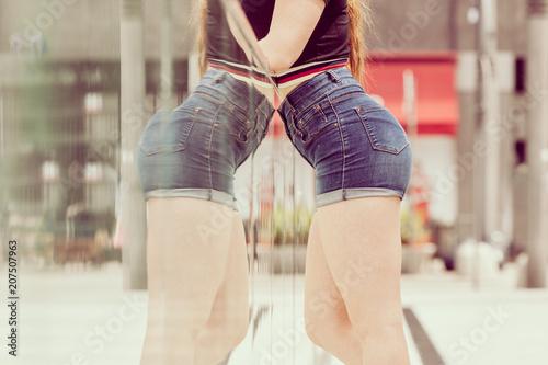 Female buttocks in denim shorts