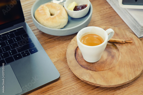 coffee break cup of espresso on working business wood table.