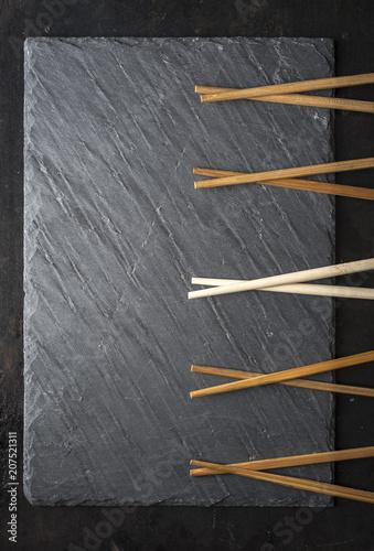 Aluminium Sushi bar Sushi black slate and chopsticks background