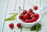 Small pannikin filled with ripe red sweet cherries
