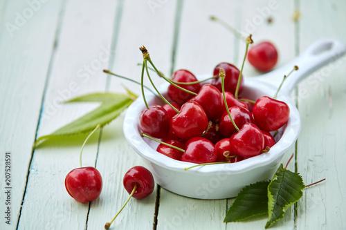 Fotobehang Kersen Small pannikin filled with ripe red sweet cherries
