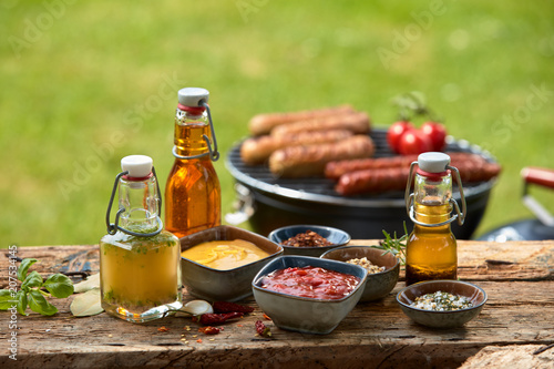 Leinwanddruck Bild Selection of dressings, sauces, marinade and spice