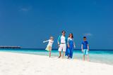 Family on a tropical beach vacation - 207535984