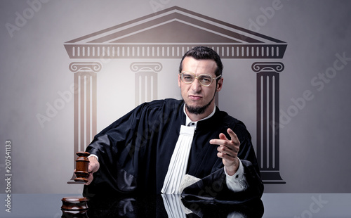 Leinwanddruck Bild Young judge in front of a courthouse symbol making decision