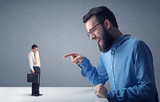 Young professional businessman being angry with an other miniature businessman  - 207544533