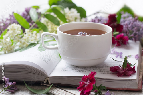 Cup of tea on opened book