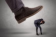 Leinwanddruck Bild - Employee is afraid of the big boss foot, which is stepping down him
