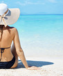 Leinwanddruck Bild - Sensual woman relaxing on a tropical beach
