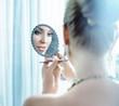 Leinwanddruck Bild - Young, elegant lady doing a makeup