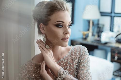 Fotobehang Konrad B. Closeup portrait of an elegant woman wearing expensive jewelry