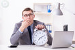 Leinwanddruck Bild - Businessman employee in urgency and deadline concept with alarm