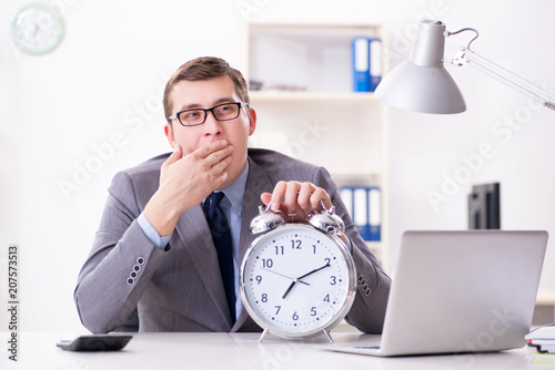 Leinwanddruck Bild Businessman employee in urgency and deadline concept with alarm