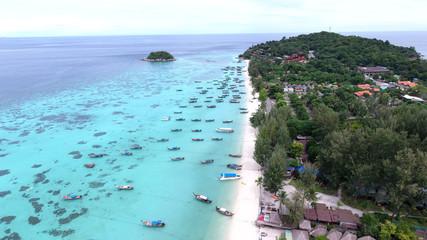 Bird's eye view of tropical beach and rocky coast with crystal clear turquoise water on LiPE island, sunrise beach,Koh Lipe,Thailand