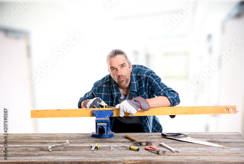 worker in blue shirt working with wood