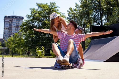 Aluminium Skateboard Happy young couple having fun with skateboard in the skate park