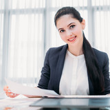 company recruiter. young professional business hr. female office manager holding a paper with resume or job application form - 207596529