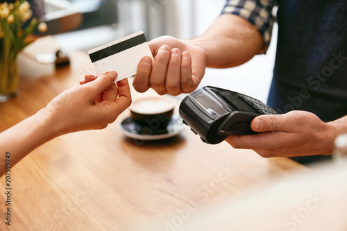 Customer Paying With Credit Card In Coffee Shop Closeup