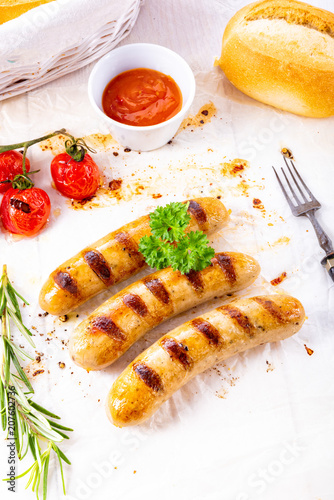 Foto Murales delicious bratwurst with ketchup and fresh rolls